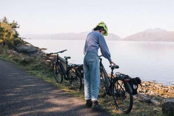 Woman on E-bike on Caledonia way cycle track, hired from Woodlands Glencoe, Scotland